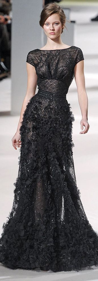 Consider wearing a black ruffle evening dress to look truly gorgeous.   Shop this look on Lookastic: https://lookastic.com/women/looks/black-ruffle-evening-dress/22842   — Black Ruffle Evening Dress