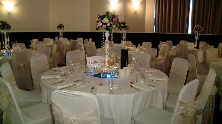 White crystal stand with fresh flower arrangement centrepiece  www.houseofthebride.com.au