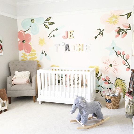 This nursery coming to us from Heather Scott of Jupe & Olive looks like the perfect comfy spot for mama and her girl to cozy up together, don't you think?  //Floral pastel nursery// 100 Layer cake