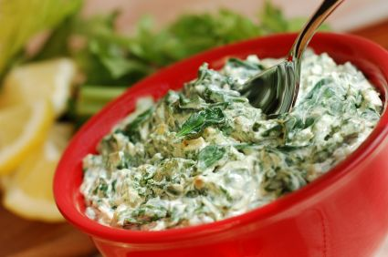 Todd Wilbur's Healthier Artichoke Spinach Dip: Using reduced-fat cream cheese and Greek yogurt, this recipe cuts the fat and calories of the original dish nearly in half!