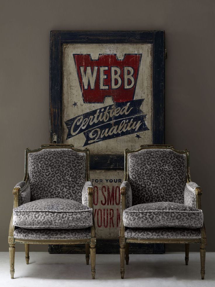 #andrewmartin #interiordesign #furniture #pattern #cheetah #grey #rustic #vintage #sign #chair
