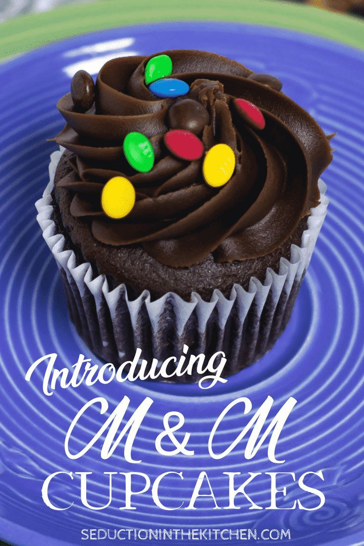 M&M Cupcakes is an easy chocolate decadent cupcake that your family will love. Adding the candy M&M's to the top of the cupcakes makes these cupcakes even better! You are going to love this chocolatetreat. | Seduction In The Kitchen #cupcakes #chocolatecupcakes #M&M #decadent #dessert #yummy #recipes #chocolate