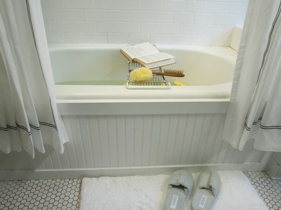 Update a standard tub with bead board surround. Love this idea! Looks so expensive and relaxing!