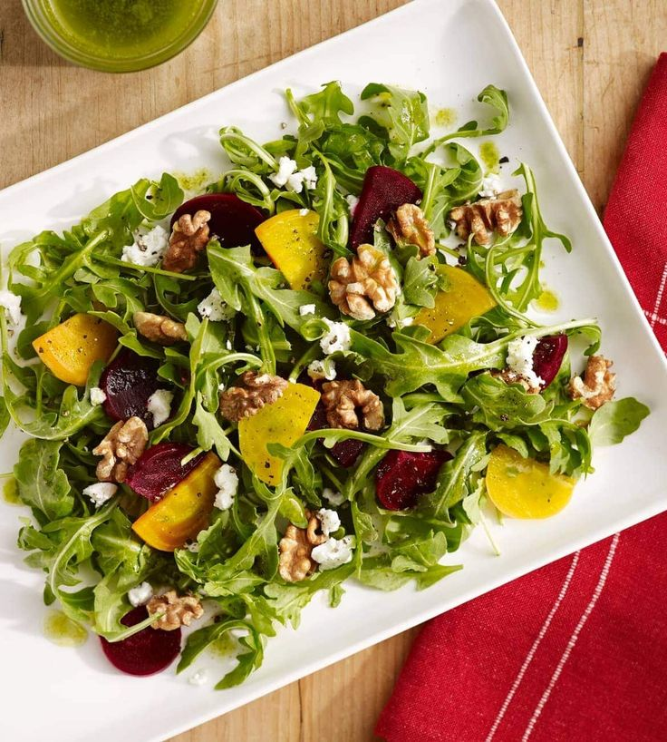 Rich goat cheese and beets complement the lightness of the arugula and basil in this salad.