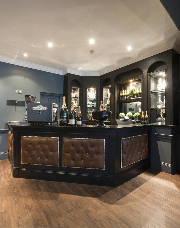The Roxburghe Hotel, Edinburgh. A stylish hotel Bar by Glasgow based Interior Designers, Occa Design. Tan Leather Panelling, Button Detailing, Studs, Back Bar, Gantry, Grey Blue Interiors