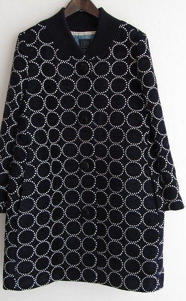 Can't get enough of those circle motifs...Mina Perhonen coat - Tambourine textile.