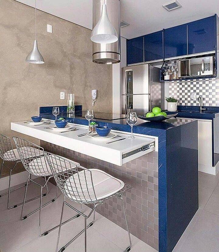 Cozinha Com Balcao Retratil Decorada Com Azul Escuro Cimento E