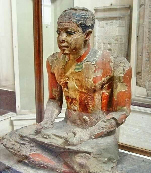 Mitri depicted as a scribe, painted wooden statue. Old Kingdom, 5th Dynasty c 2500 BCE