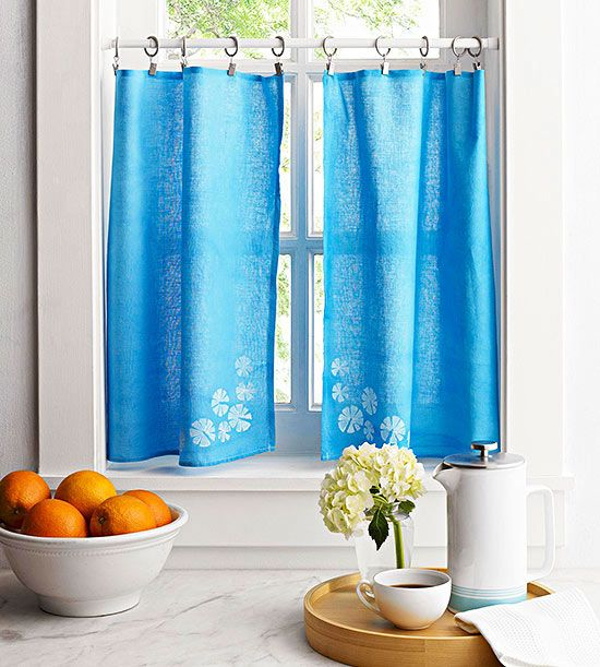 Humble flour sack dish towels become cute and customized window treatments with fabric dye and a stamp made from a potato.