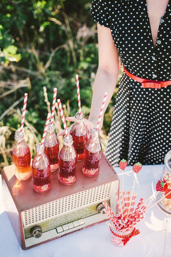 fifties inspired wedding reception with vintage coke bottles #vintage #polkadots #weddingchicks http://www.weddingchicks.com/2014/01/22/rockabilly-wedding-ideas/