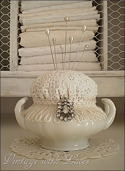 Love this pretty pincushion made from old lace and old china! Using vintage fabric for the top would work just as well. mamasmiracle.com