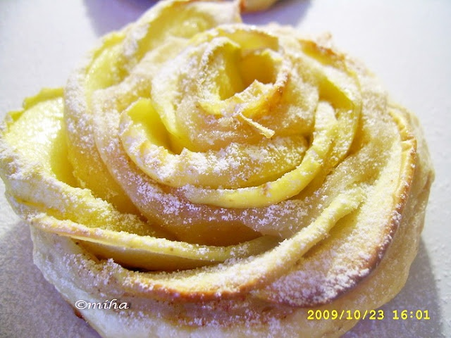 Apple Roses...this recipe is written in Romanian...translated to: 1 pound pastry dough, 3 apples (sliced thin), 6 T sugar, 2 T cinnamon, juice of 1/2 lemon.  The apples are boiled in water and lemon juice until pliable.  I don't speak Romanian, but used a translater to help.  Will be trying this...so pretty!