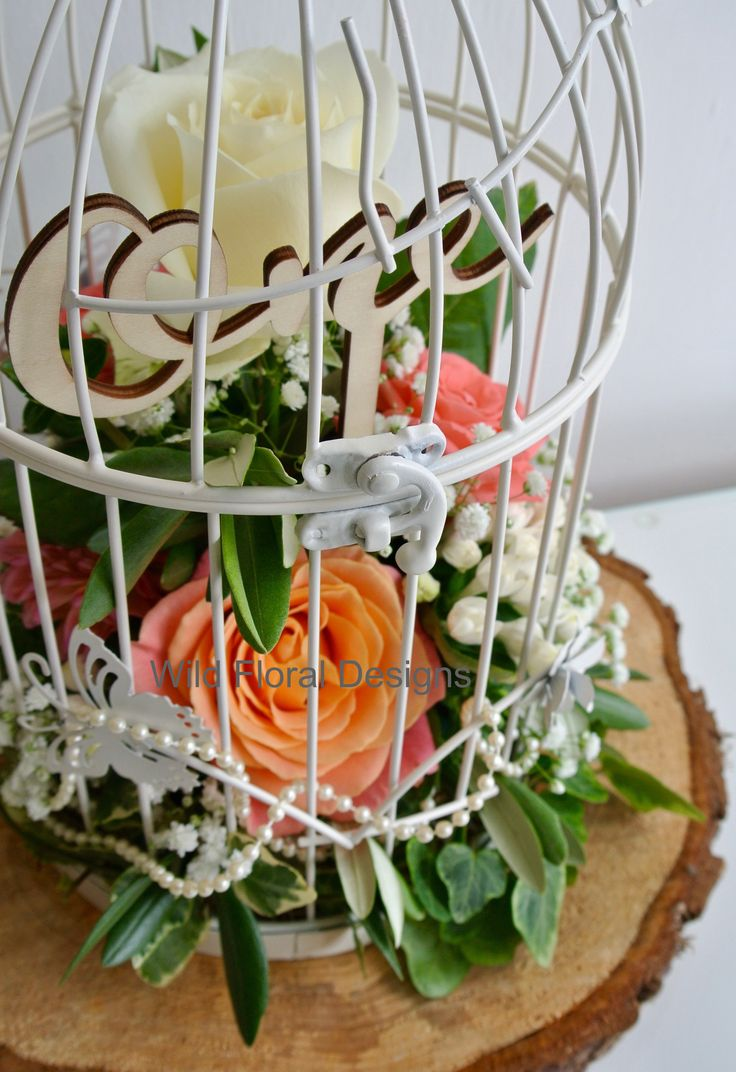 Bird cage, log slice, flowers, coral, pearls, table number, vintage table design.