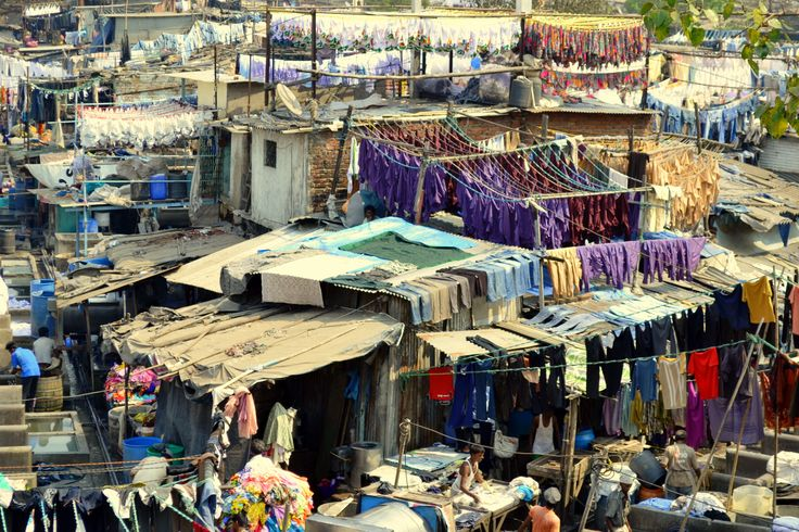 Bombay - The well-known Dhobi Ghat open air public laundry facility. Where Dhobis hand wash for local hotels and hospitals. Amazingly efficient system and a must see! Smells soapy clean!