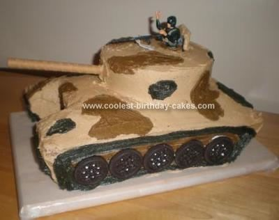 Homemade Army Tank Birthday Cake: Want a slice of cake?!  This Army Tank Birthday Cake was created by 2- 9x13 Pillsbury Yellow sheet cakes and 1- 6 round cake.  It was assembled using good