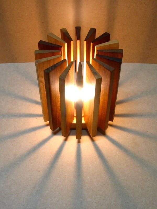 A lamp made from recycled wooden pieces recovered from a carpenter's workshop.