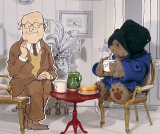 Paddington Bear. Mixed-media 1970s style. In 1975 Paddington first appeared on the television. Made by FilmFair in the UK, the tv series used a technique of combining a three-dimensional Paddington puppet with two-dimensional backgrounds and other characters.