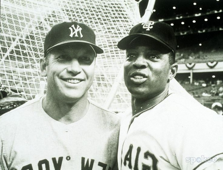 Mickey Mantle with Willie Mays. -- Who was better: Mantle or Mays? Fifty years after their rookie season, we're still debating it. ~Allen Barra