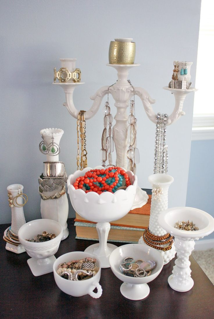 display jewelry in milk glass dishes- cute  I don't think I would do it but I just like the look of it.