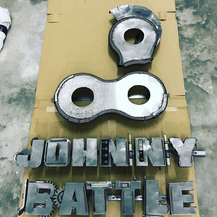 Our Logo that was made into a metal sign! #embroideredlogos #metalsign #Johnnybattle
