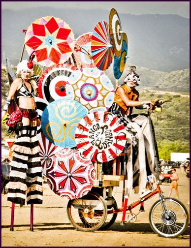 Stilts and umbrella wagon - the circus is in town!