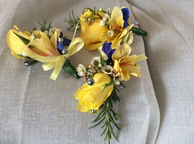 Yellow corsages on magnets by cathey's flowers