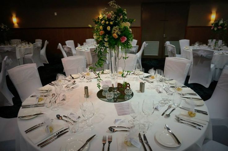Tall floral centrepieces.