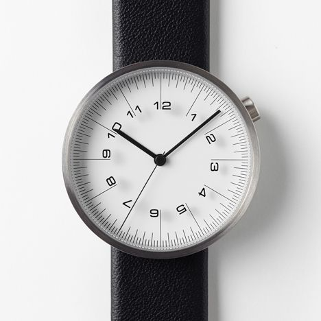 Japanese design studio Nendo  Hour markers are printed directly onto the lenses of the 36mm men's and 28mm women's editions, and each watch comes with a calf-leather strap. Click here to find out more or order Draftsmen 01-Scale from Dezeen Watch Store »