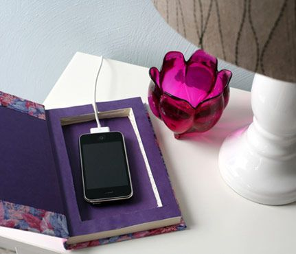 Weekend DIY Projects: Cell-Phone Charging Station. What better way to hide your cell phone's charging cord on your nightstand than with a hollowed-out book? #SelfMagazine