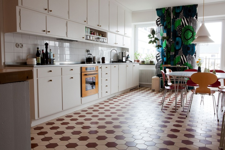 Tiled kitchen and yellow oven!