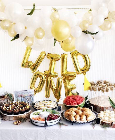 Find out how you can DIY your own Where The Wild Things Are first birthday party for your wild one! Treat ideas, balloon arch, balloon banner, high chair banner, diy outfit and slippers!