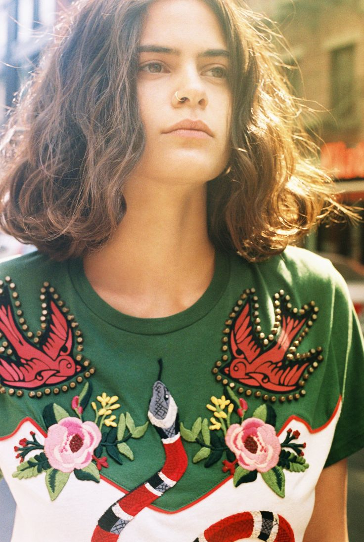 Lexie Smith in a Gucci embroidered T-shirt with snake, flower, and swallow appliqués