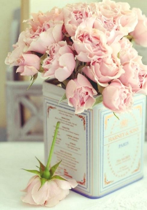 Light pink floral arrangement in a Harney and Sons tea package. Great #DIY idea for your #wedding #flowers.