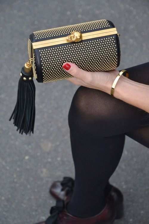 Alexander McQueen North South Studded Clutch with chain strap. https://cultstatus.com.au/products/alexander-mcqueen-north-south-studded-tassel-skull-clutch#.V4zllegrLuo