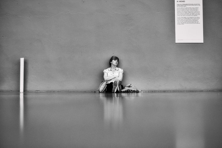 Woman sits in Tate Modern