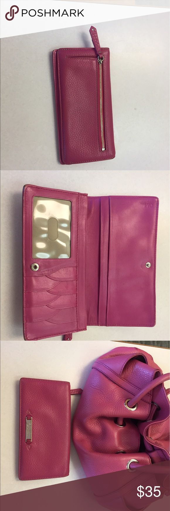 Cole Haan pink wallet. Cole Haan soft pink pebbled leather wallet. Slightly used in good condition.  Matching Cole Haan purse in my closet. Cole Haan Bags Wallets