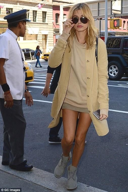 Hailey Baldwin wearing Timberland Premium Boots in Angora, Anine Bing Suede Skirt and Zara Cotton Overshirt in Tan