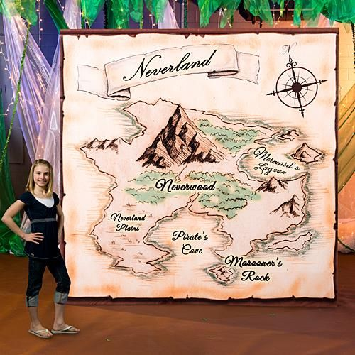 """Neverland Map Background Standee - Our one of a kind Neverland Map Background Standee will be the focal point of your event. This cardboard prop measures 9' 4"""" high x 9' 4"""" wide and is printed on one side. Easy assembly is needed to make this prop free standing with the included cardboard brace. Bring an imaginary world to life with the Neverland Map Background Standee."""