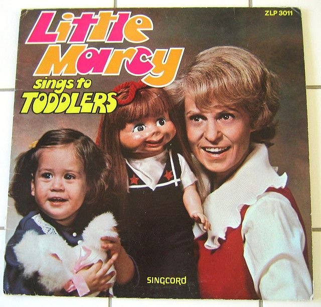 Creepy Album Cover of Woman with Puppets