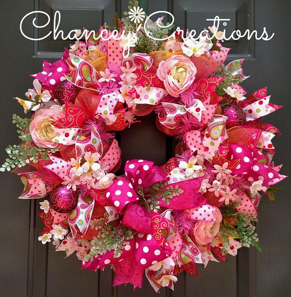 Summer Wreath, Front Door Wreath, Flower Wreath, Deco Mesh Wreath, Floral Wreath Hold on to the Summer fun with this pink lemonade inspired Floral Deco Mesh wreath. Constructed on a wire wreath frame using two different patterns of deco mesh, hot pink and gold two tone as well as a yellow, pink and gold strip. Loaded with silk flowers and six different patterns wired ribbon. Wire wreath frame - 23x23x7 READY TO SHIP! Wreaths make great gifts. If you would like me to send a personalized…