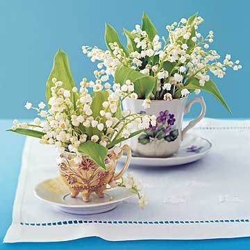 Vintage teacups make pretty containers for tiny flower arrangements. Fill the cups with well-soaked floral foam or use a small metal florist's frog, if necessary, to hold the flowers in place. Look in your yard or at the flower shop for small blooms, such as grape hyacinth or lily-of-the-valley, that match the scale of the cups.