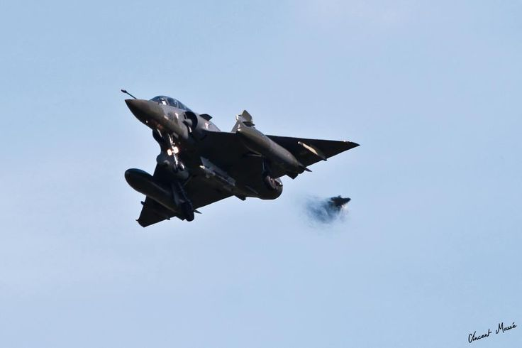 Exercise Serpentex 2014 in full swing at Mont-de-Marsan. French Armée de l'Air Dassault Mirage 2000D, equipped with a GBU, prepares to land on the BA118. A second Mirage 2000D follows barely visible in the jet wash of the first.