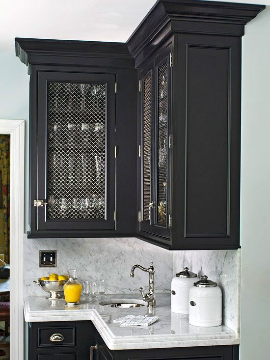 Bold Black Cabinets Fitted With Wire Mesh Door Fronts