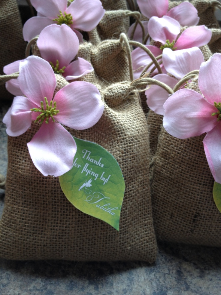 Tinkerbell party favor bags - burlap bags with a flower hot glued on & paper leaf thank you tags
