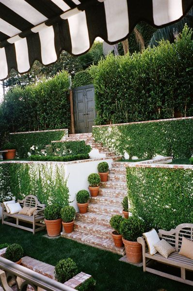 Black and white striped awning in a Hollywood Hills garden. Design by Mark D. Sikes