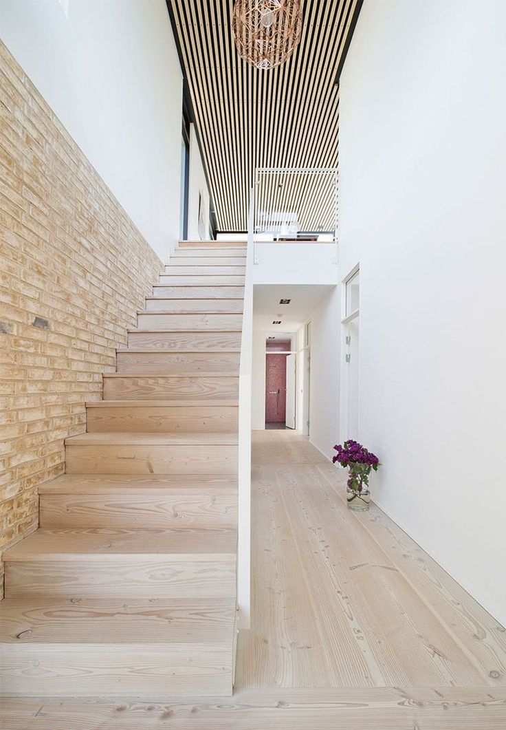 Bright and airy look with this staircase in light wood with a white railing. A beautiful sight.
