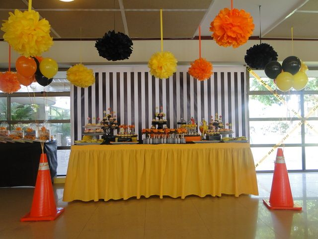 Construction theme party. I love the use of large cones to anchor the balloons. The construction tape over the windows is another nice touch.
