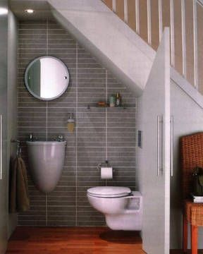 This is sooo cute! A space that would normally be wasted turn into a tiny but beautiful bathroom :)