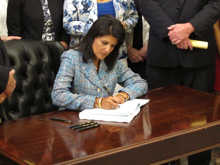 South Carolina Gov. Nikki Haley signs the state's new domestic violence bill into law on Thursday, June 4, 2015, in Columbia, S.C. The new law increases penalties for domestic violence and has a gun ban for batterers. (AP Photo/Jeffrey Collins) via @AOL_Lifestyle Read more: http://www.aol.com/article/news/2016/11/23/gov-nikki-haley-accepts-trump-offer-to-be-ambassador-to-united/21612611/?a_dgi=aolshare_pinterest#fullscreen