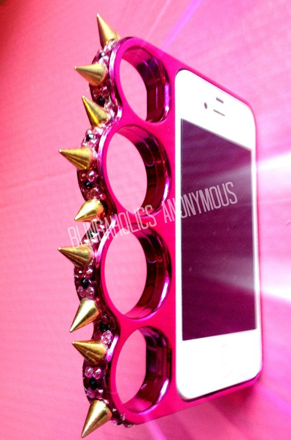 Pink Bling Brass Knuckles iPhone 4/4s Case by BlingaholicAnonymous, $45.00 @Valerie Avlo Pursley @Candice Casey I totally want this case... imagine punching someone in the throat with this thing! add a taser to the tips of the spikes and it would be perfect! just sayin...